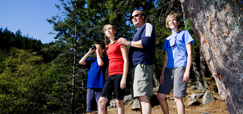 A family hikes in Gulf Islands National Park Reserve