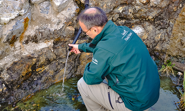 Ernie Gladstone, Superintendent, Gwaii Haanas, looks at the water flowing into the pools on Hotspring Island
