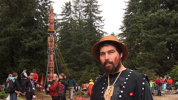 Gwaii Haanas Legacy Pole 2013 - The Gwaii Haanas Legacy Pole is a 42-foot monumental pole commissioned by a unique cooperative management board made up of equal members of the Haida Nation and the Government of Canada. Known as the Archipelago Management Board (AMB), the body is renowned throughout the world as a model for cultural and natural resource governance. The pole was carved to honour the 20th anniversary of the Gwaii Haanas Agreement, the cornerstone of a groundbreaking relationship that protects the natural and marine resources. The Gwaii Haanas Legacy Pole was raised at Hlk'yah GawGa (Windy Bay) on Lyell Island on Aug. 15, 2013. This was the first pole raised in the Gwaii Haanas region in over 130 years, building a connection with the historic poles still standing in the villages of SGang Gwaay (also a UNESCO World Heritage Site) and Skedans (K'uuna Llnagaay).