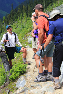 A Parks Canada interpreter tells a story to a group of hikers