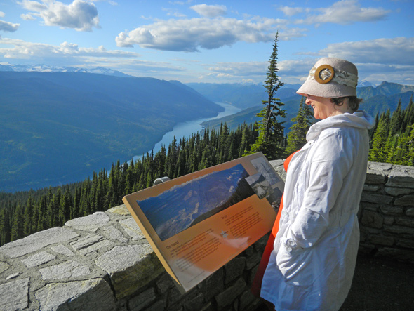 Visitor looking at the view from the summit of Mount Revelstoke