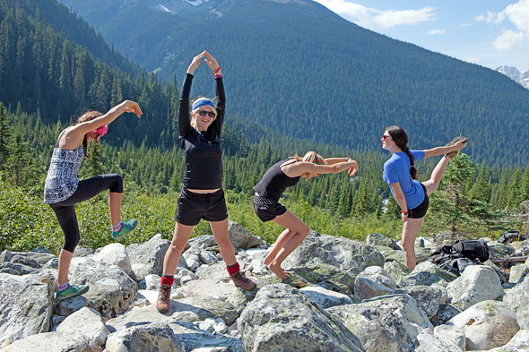 four students on a mountain spelling out 'GASP' with their bodies
