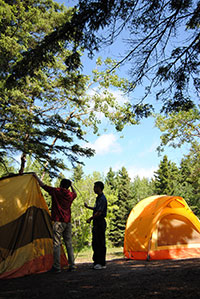 Participant setting up a tent in Riding Mountain National Park, MB