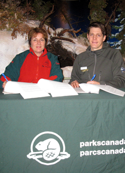 Marilyn Peckett (Superintendent, Manitoba Field Unit, Parks Canada) and John Gunter (General Manager, Frontiers North Adventures) sign the first License of Occupation of Wapusk National Park
