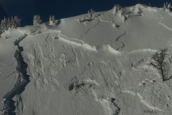 A slab avalanche leaves behind a pronounced fracture line.