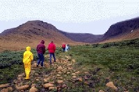 Hikers entering Winterhouse canyon on Tablelands Trail