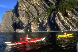 Two kayakers near cliffs of Bonne Bay