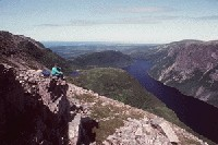 Hiker on top of Gros Morne Mountain