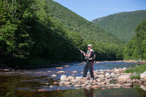 Man fishing in Cape Breton Highlands