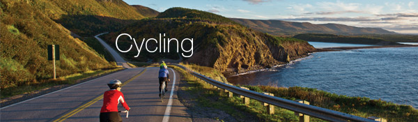 Two visitors travel along the Cabot Trail on their bicycles