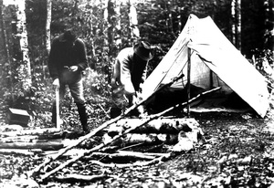 Two men at hunting/fishing campsite (historic photo)