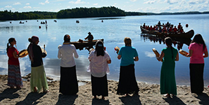Participants in the canoe festival at Kejimkujik wait for canoes to arrive.