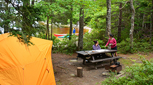 Campers enjoy a quiet moment in Kejimkujik's backcountry.