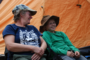 A Girl Guide and Leader share a laugh at their campsite in Nahanni National Park Reserve of Canada.