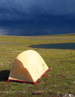 tent with thunderstorm incoming