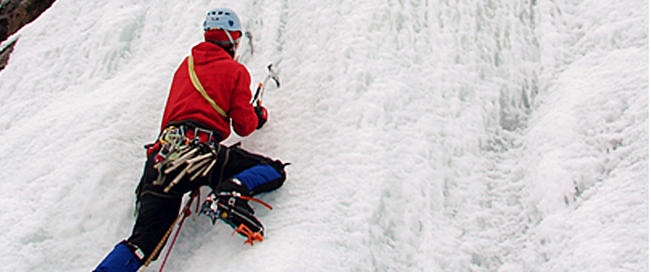 A man doing ice-climbing.