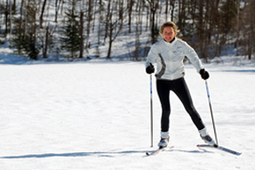 A woman doing cross-country skiing.