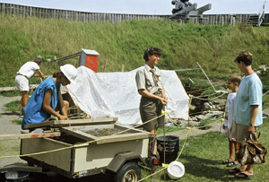 Visitors and archaeologist at an excavation site at Fort Wellington NHS of Canada (Ont.)