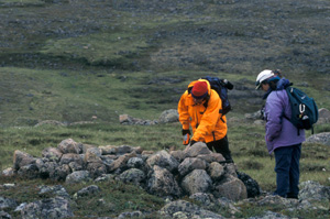 Parks Canada archaeologist at Thule site near Sila River at Ukkusiksalik National Park of Canada (Nun.)