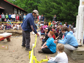 Parks Canada archaeologist presenting archaeology programme to Camp Kitchikewana participants