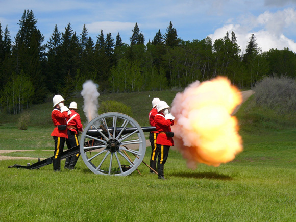 A Nine Pound Muzzle Loading Field Rifle being fired on the Parade Grounds at Fort Walsh NHSC