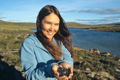 A young Inuit woman shows her appreciation of a gift from the Earth