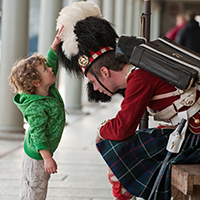 Highlander and young boy chatting
