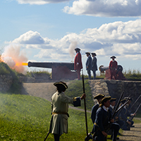 Canon fire with soldiers around it