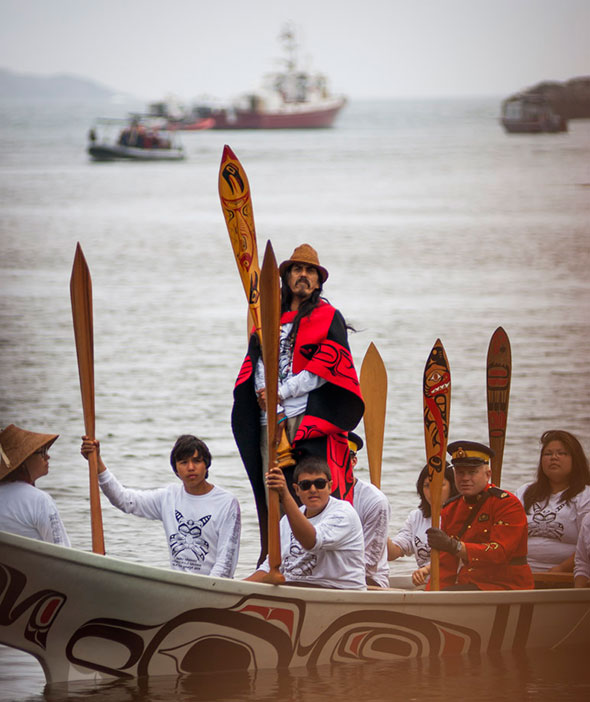 A Haida canoe arrives at Hlk'yah GawGa (Windy Bay) in Gwaii Haanas for the pole raising on August 15, 2013