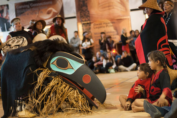Haida dancers with a Raven mask