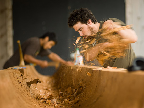 Tyler (left) and Jaalen (right) hollow out the log