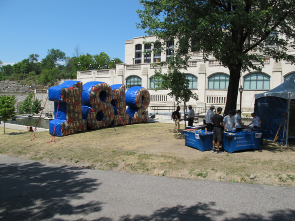 Huge inflatable 1812 numbers with tents on the Rideau Canal in Ottawa