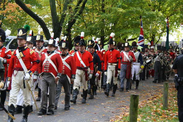 Military parade of re-enactors in period costume at Queenston Heights in Queenston, Ontario
