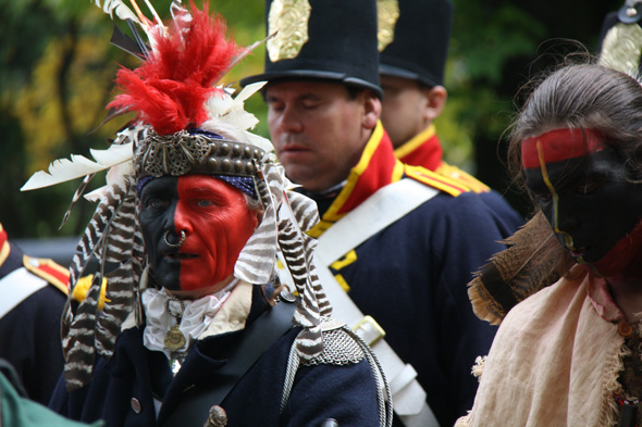 Re-enactor in period costume dressed as a First Nations ally at Queenston Heights in Queenston, Ontario