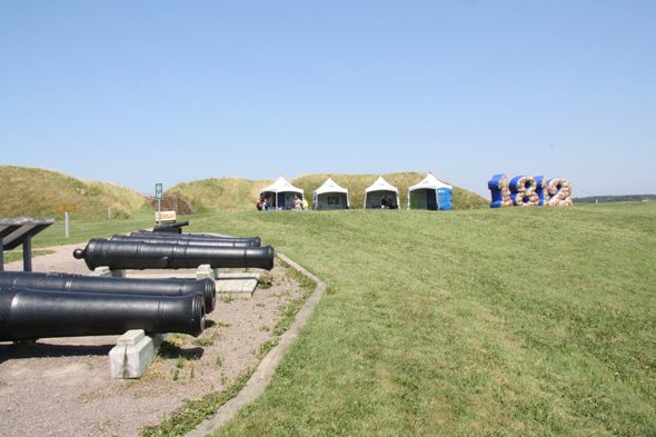Cannons and huge inflatable 1812 numbers with tents at the Fortifications of Québec National Historic Site
