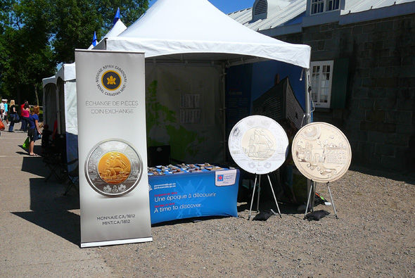Royal Canadian Mint display in front of 1812 On Tour tents