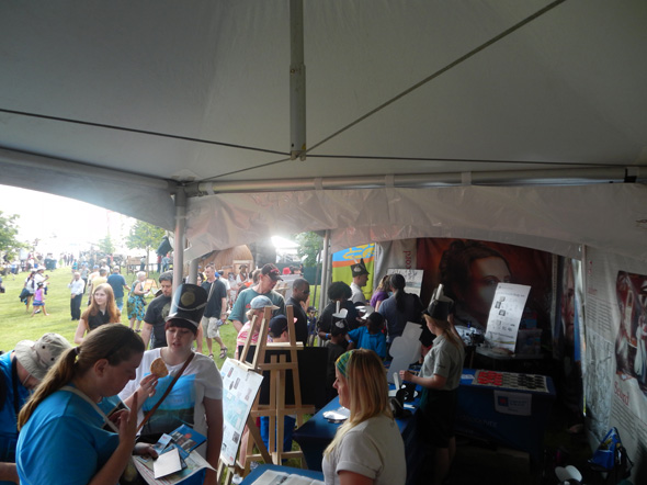 A crowd of people inside the 1812 On Tour tents at the Redpath Waterfront Festival in Toronto, Ontario, 2013