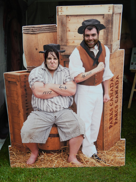 A young couple poses for a fun photo at the 1812 On Tour kiosk in Brockville, Ontario, 2013