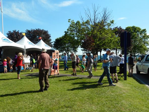 Visitors enjoying the sun and 1812 On Tour at the Tall Ships Festival in Brockville, Ontario, 2013