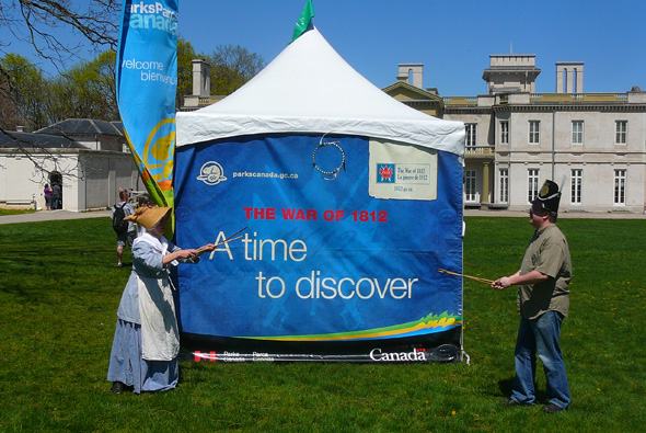 1812 On Tour staff member playing a game with a visitor in front of Dundurn Castle National Historic Site in Hamilton, Ontario, 2013