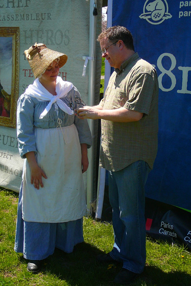 1812 On Tour staff member in period costume sharing stories with a visitor in Hamilton, Ontario, 2013