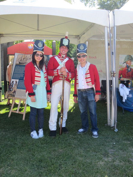 "British soldiers"" ready to defend Kingston at the 1812 On Tour kiosk, 2013"