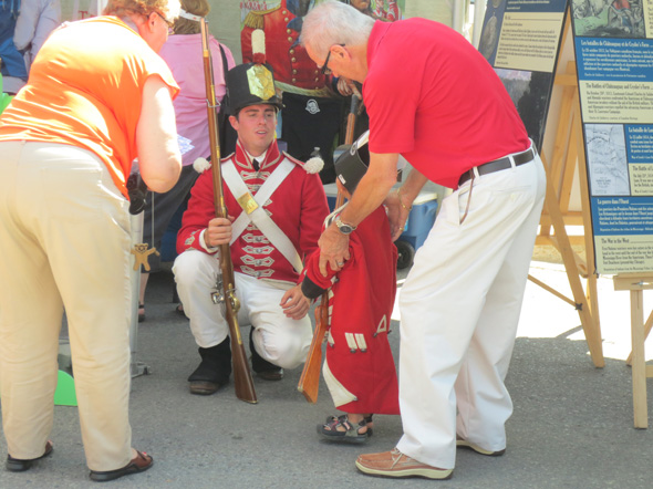 Grandparents and grandson at the 1812 On Tour kiosk during the Tall Ships Festival at Penetanguishene, Ontario, 2013