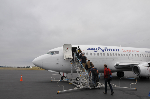 Crew members board a charter flight at Victoria, British Columbia en route to Kugluktuk, Nunavut on August 9, 2011.