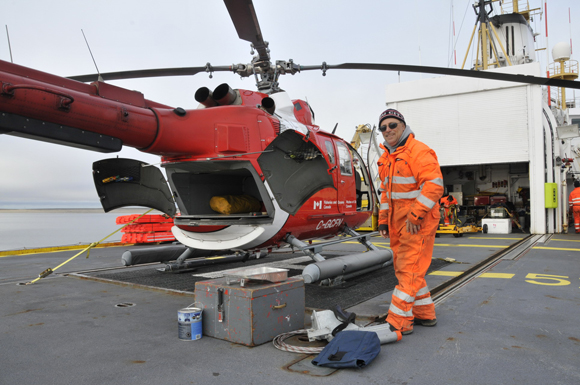 Navigation Aids Technician Christian Girard loads the helicopter prior to navigation aids work on shore.