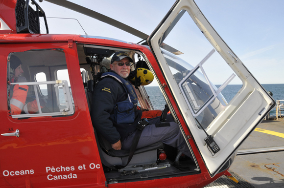 Helicopter Pilot Andrew Stirling and Health Officer Jenny Begin (back seat) prior to deployment to Search and Rescue (SAR) call on the Boothia Peninsula.