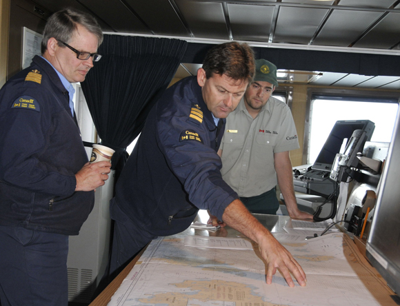 Commanding Officer Stuart Aldridge (left), Chief Officer Simon Dockerill and Ryan Harris during a survey logistics planning session on the bridge.