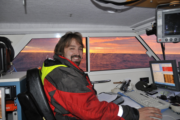 Canadian Hydrographic Service hydrographer Arthur Wickens aboard the Kinglett during surveying.