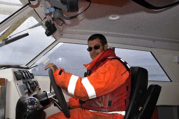 Canadian Coast Guard coxswain Kurt Westle at the helm of the Kinglett.