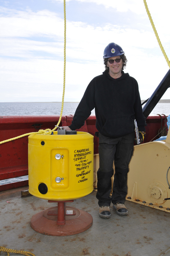 Glenn MacDonald (CHS) with assembled tide gauge, prior to deployment near Cambridge Bay.